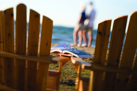 Chairs to relax in on the private sandy beach of Tamarack Lodge