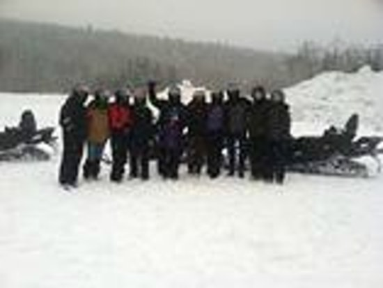 SledVentures Snowmobile Rentals and Tours: 11 friends from 9 years old to 56 years old on guided snowmobile tour
