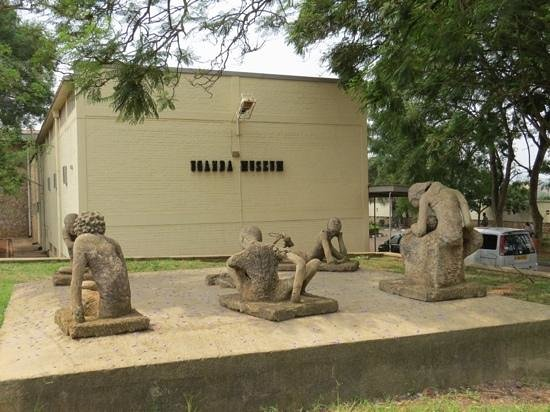 Uganda Museum: broken statues at the entrance are consistent with the interior
