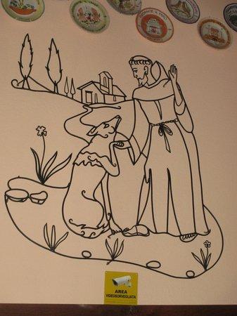 Taverna del Lupo: Appeso alla parete in ferro una scena famosa relativa alla vita del santo