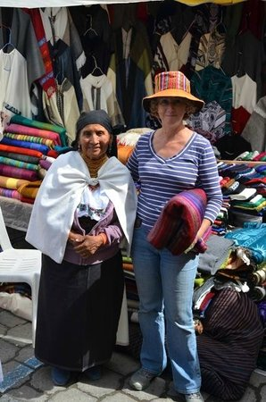 Otavalo Market : Nathalie with a local vendor from which we purchased a few blankets!