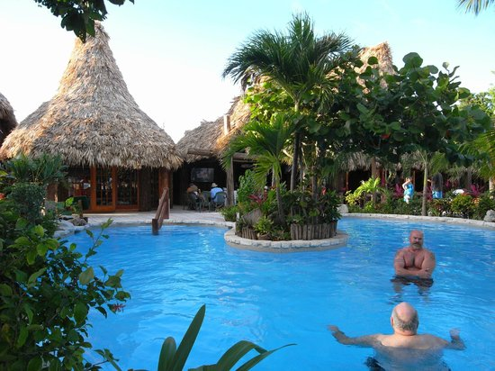 Ramon's Village Resort : Pool with small shop; bar and restaurant beyond
