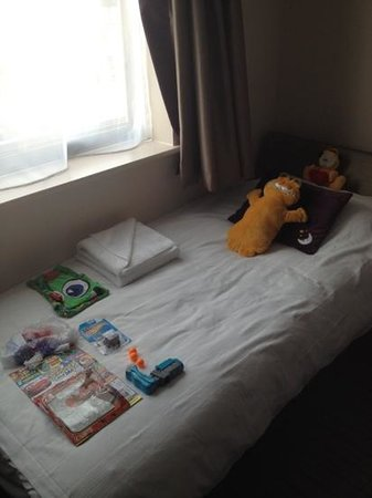 Premier Inn Trowbridge Hotel: Nicely laid out bed for our son when we came back