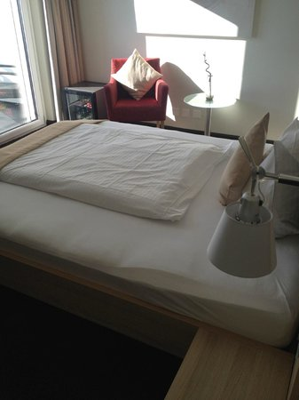 Hotel Oberland: The bed and the strange 1/2 quilt. :)