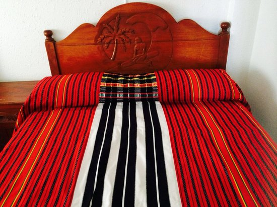 The Little Surfmaid Resort: A firm and comfortable queen size bed ... in true Ilocano-woven bedcovers