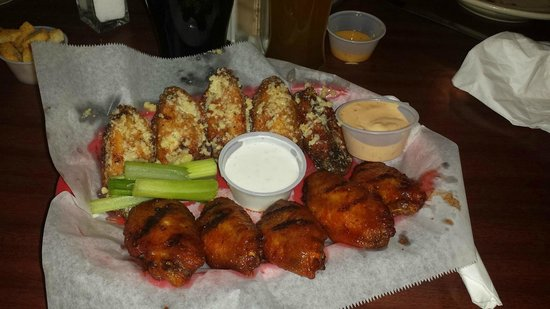 Jekyll and Hyde's Grill Spirits and Sports : half honey-saraicha, half garlic-parmesan wings