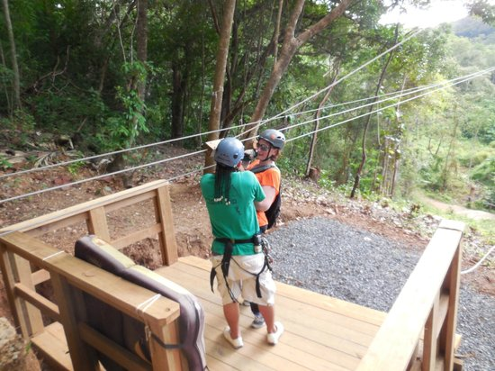 Clip N  Zip Canopy Tours: Marlon helping my wife get un-clipped