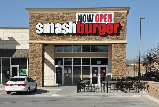 Smashburger: Clean lines and interesting textures make an inviting entry. Notice the patio tables.