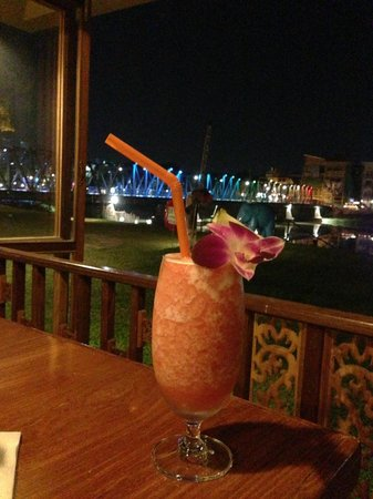The River Market: Tasty and pretty fluff drink w a view of the iron bridge.