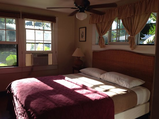 Waimea Plantation Cottages: #57 bedroom with sunset through windows