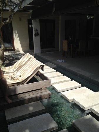 Chandra Luxury Villas Bali : From entrance with pool on left, living on right, cute stepping stones