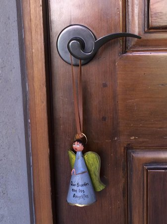"Rosewood San Miguel de Allende: ""Dreaming with the Angels"" (do not disturb) sign for the door"