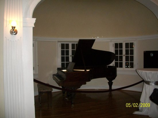 Stanley Hotel Tour: you can see someone sitting at the piano