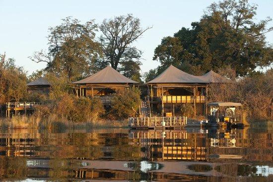 Wilderness Safaris DumaTau Camp: DumaTau Camp as Seen from the Lagoon