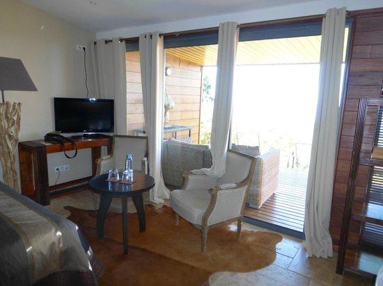 Diana Dea Lodge : le petit salon dans la chambre