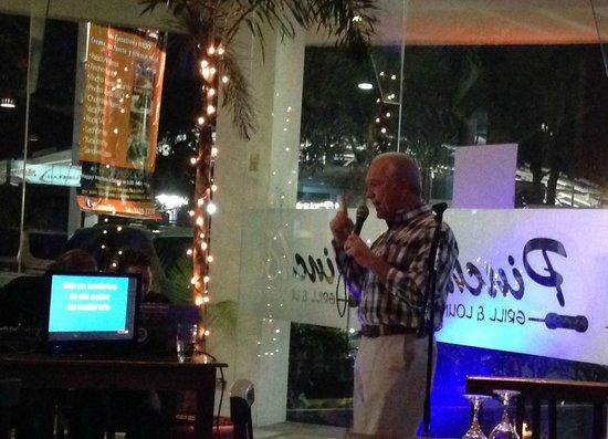 Pinchos Grill & Lounge: Arturo (owner) sings a little karaoke at Pincho's