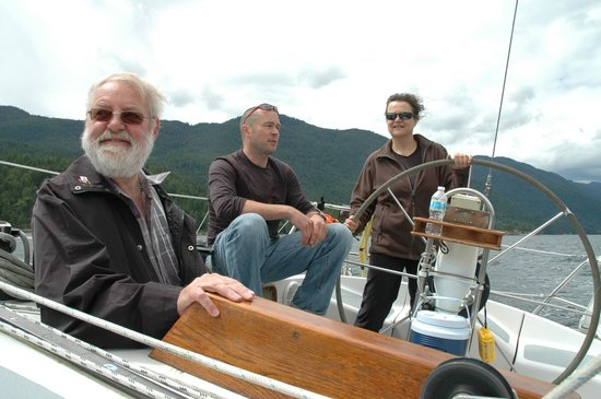 BC Sail Tours: A guest enjoying the helman's duties