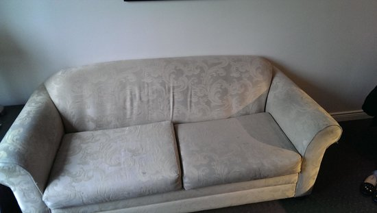 Century Plaza Hotel & Spa : Ratty, stained couch