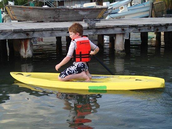 El Milagro Beach Hotel and Marina: Paddleboarding with my son