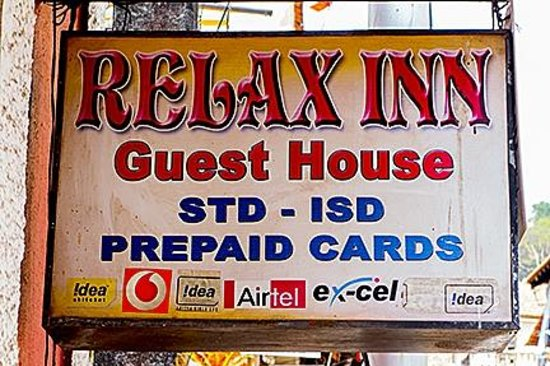 Street sign identifying Relax Inn.