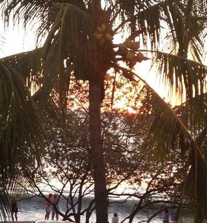 Flamingo Beach Resort & Spa: setting sun as seen from upper bar/ restaurant