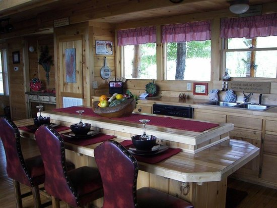Brother's Cove Log Cabin Rentals: Kitchen has 5 chairs around eat in bar