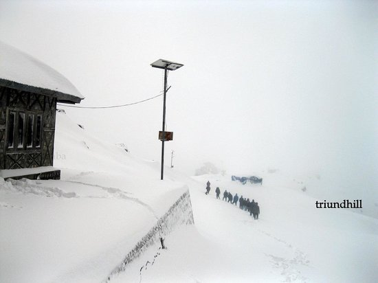 Retreat from Snowy Triund Hill,  Dec 2013