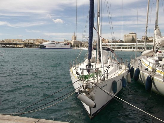 Puerto de Málaga : Your Port of Call. Admire the yachts and ships.