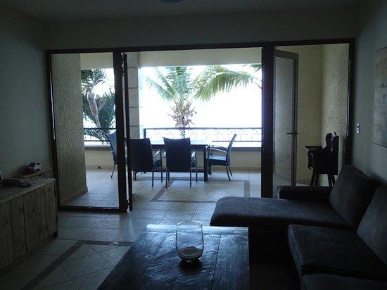 Bellafonte Luxury Oceanfront Hotel : View of the living room, both balcony doors open