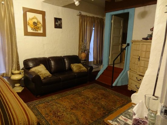 Bisbee Grand Hotel: Comfy couch and cabinet with TV