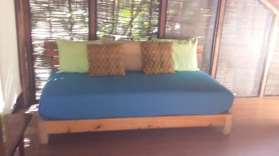 Vida Silvestre: Living area couch-Mosquito net is hung if used as bed