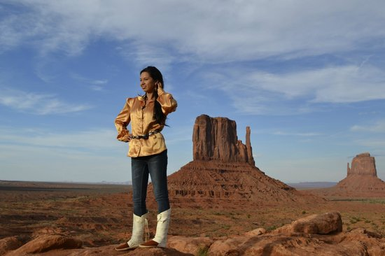 """Majestic Monument Valley Touring Co.: in front of """"Left Mitten"""" in Monument Valley Navajo Tribal Park."""