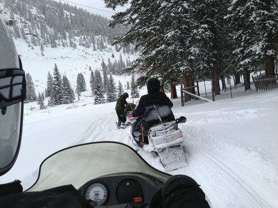 Monarch Snowmobile Tours: Stopping at a historical site