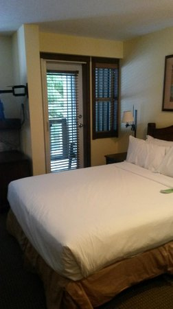 Coast Blackcomb Suites: bed in studio room