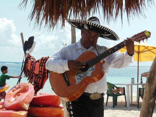 Mahahual Beach: Local entertainment passing through the Krazy Lobster beach.