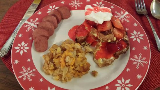 House of 1833: Croissant french toast, turkey sausage, and 1833 potatoes