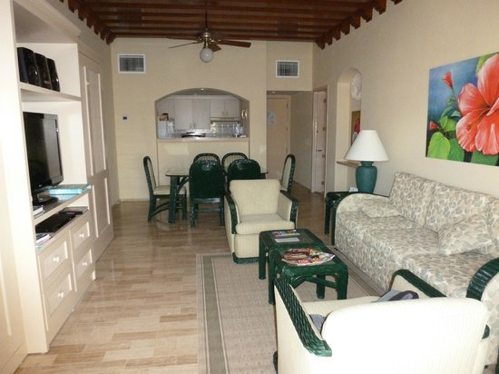 The Royal Islander All Suites Resort: Living Room, Dining Area and Kitchen in back