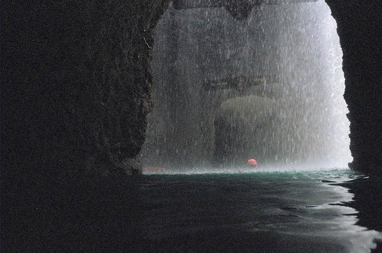 Xplor Park: Waterfall while swimming through one of the caves