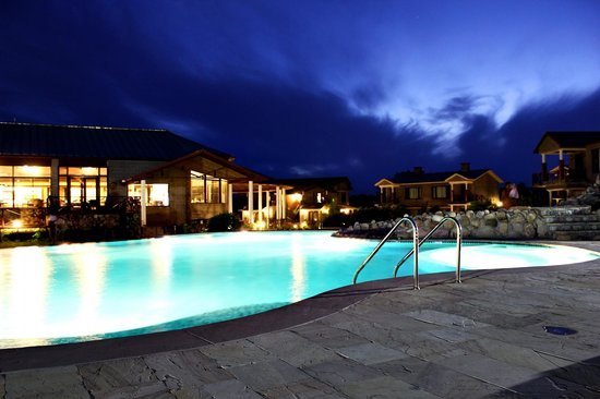 Aahana the Corbett Wilderness - an Eco Friendly Resort: pool night view