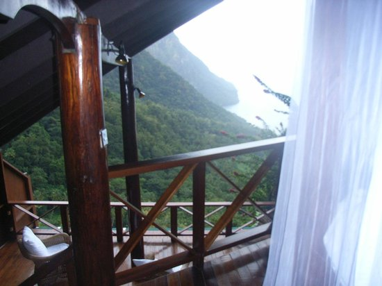 Ladera Resort: View from our bed down to the verandah and sea