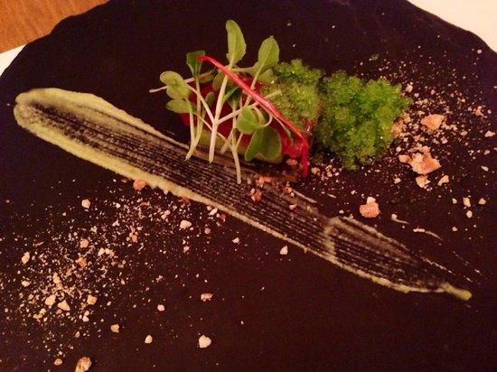 Mona: Tuna on kiwi with wasabi