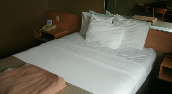 "Microtel Inn & Suites by Wyndham West Chester: Bed -- note size of ""blanket"""