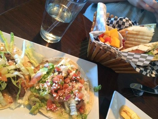 The Chimney House: Chicken Sandwich with fruit salad and Steak Tacos