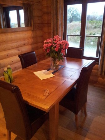 The Suffolk Escape: Dining area with lovely fresh flowers and a welcome letter.