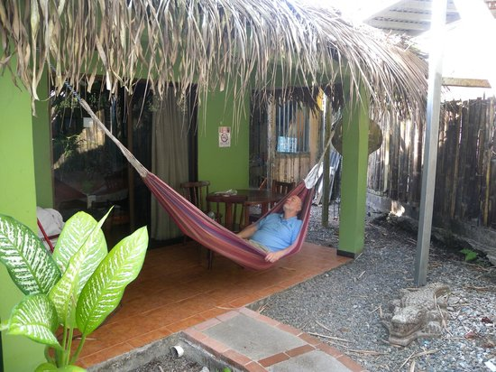 La Posada Private Jungle Bungalows: one of 6 cabinas with rocking chair, table, chairs and the hammock on each patio
