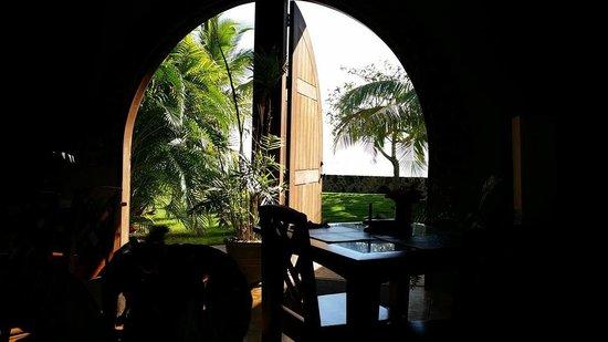 Almond Tree Hotel Resort : From inside the restaurant. Sea side doors.