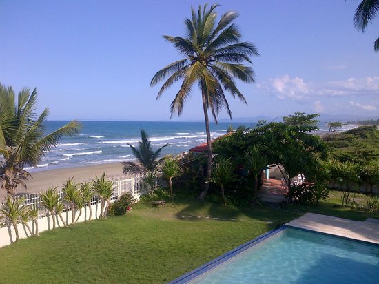 Barefoot Beach Pad: Pool area and beach from upper floor double on sunny day