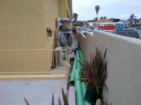 Holiday Inn Express Newport Beach: Pipe behind hotel yet to be buried