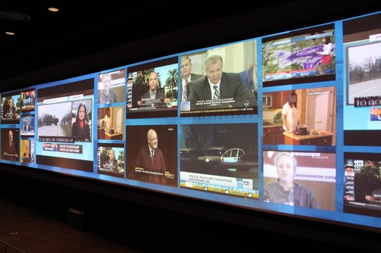 Newseum: Jumbo Screen with various newcasts being displayed.