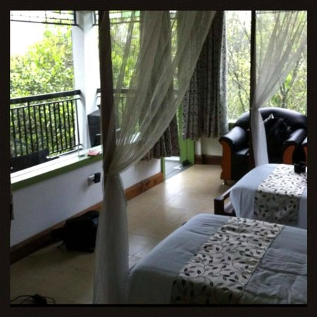 Aanavilasam Luxury Plantation House: Lovely french windows that allow alot of natural light